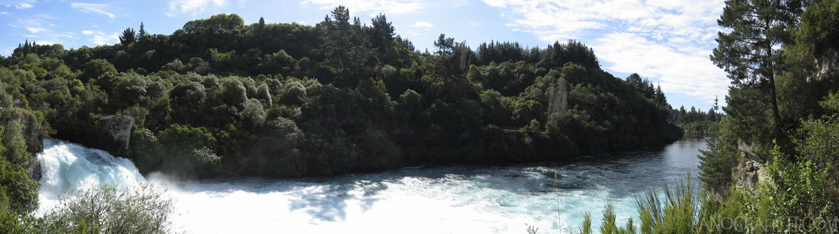 Huka Falls on the Waikato River - Flowing at 220,000 liters per second, the Waikato River squeezes through a 15 meter wide 8 meter high waterfall on its way to Lake Taupo