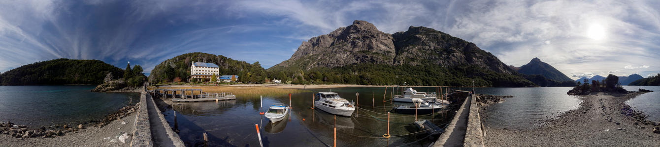 Camping Duirno Bahia Lopez 360 - A dock and a hotel situated in a beautiful calm cove on the main peninsula in Bariloche