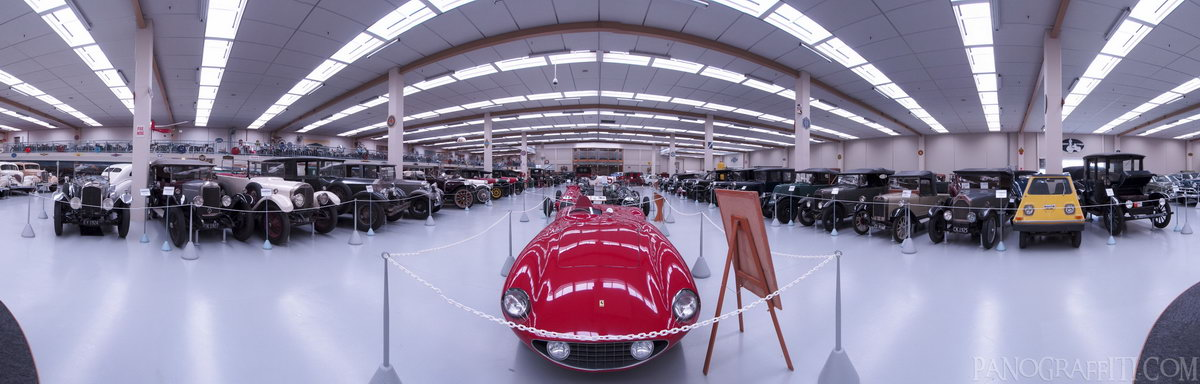A Beautiful Old Ferrari - A beautiful old ferrari in the center of a room full of cars