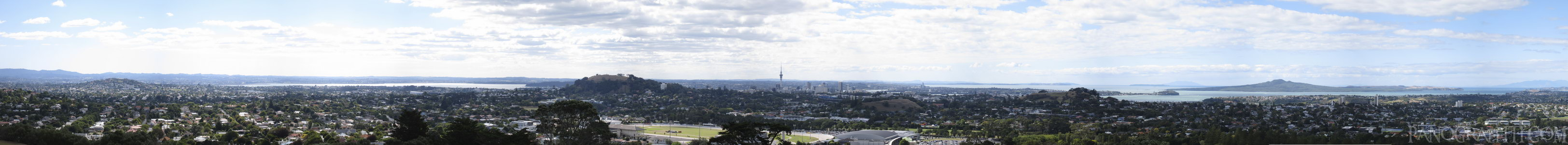 Sky Tower from One Tree Hill - The iconic Sky Tower in the center of the Auckland skyline as seen from the peak of One Tree Hill